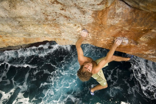 Chris Sharma rock climbing / deep water soloing in Mallorca, Spain.
